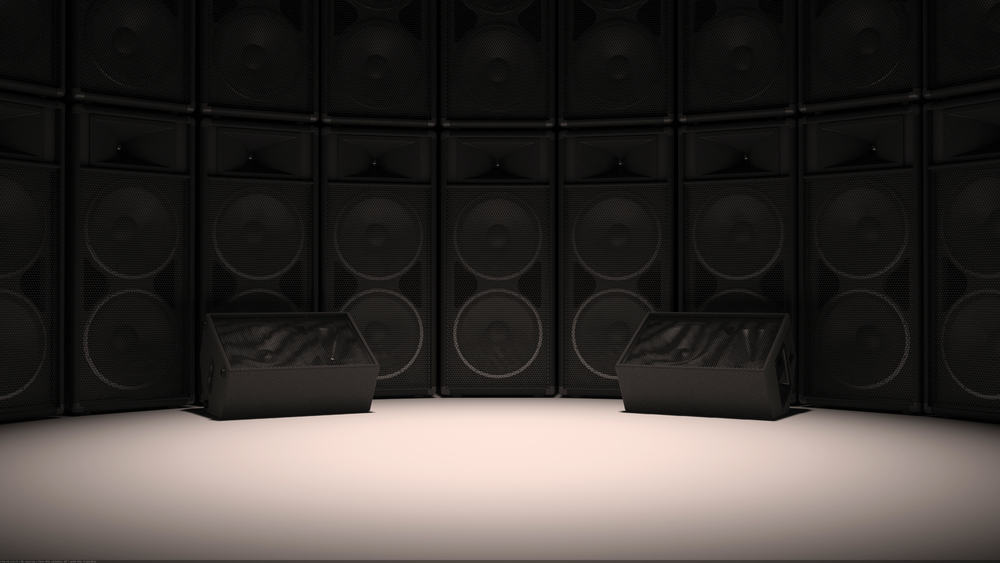 A Set of speakers set up in a studio format on a white surface with a black or dark background