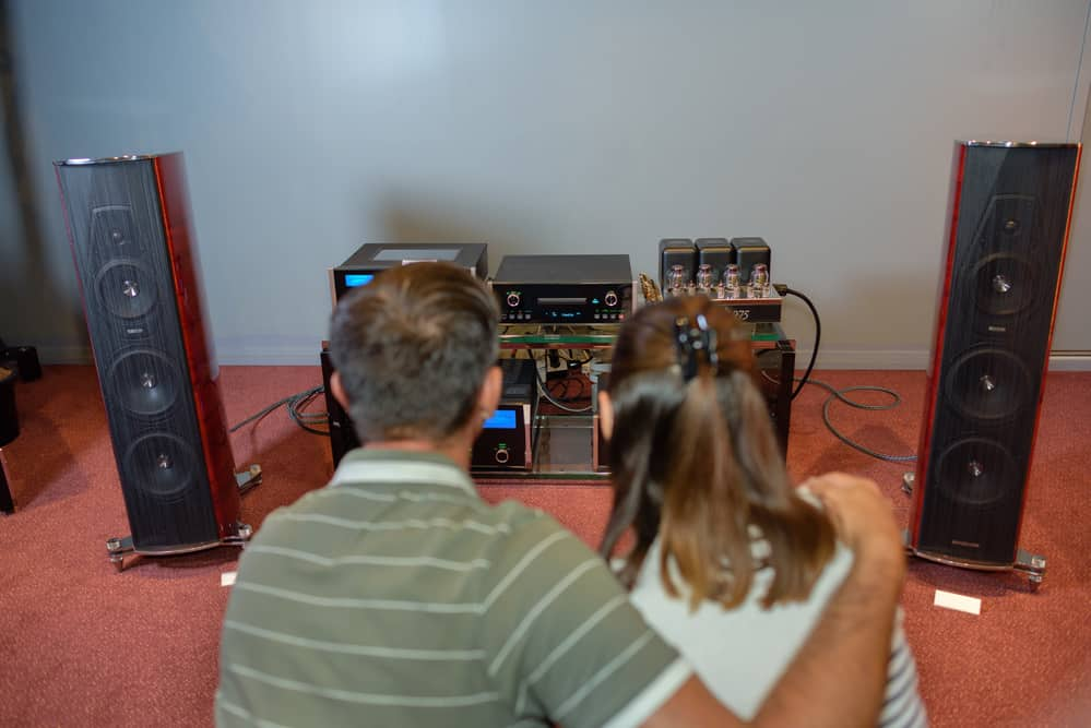 Couple looking at sound system