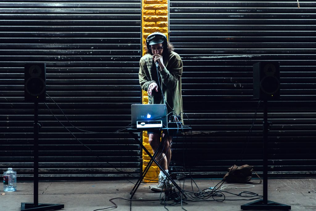 person on stage with low profile speakers
